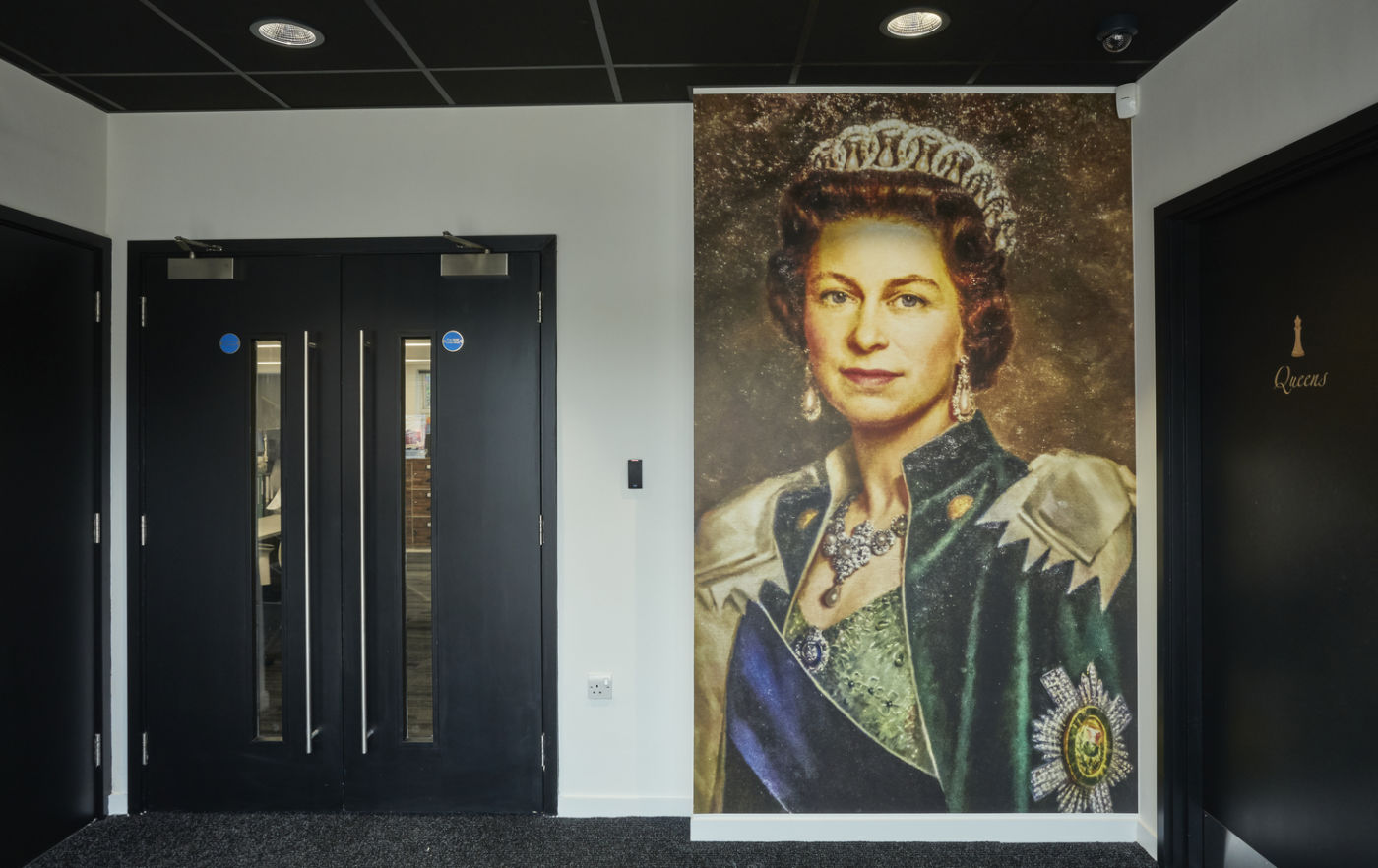 Office reception with large queen elizabeth portrait