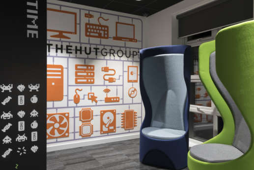 Colourful chairs and designer wall in office reception
