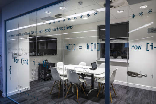 HTML code on glass meeting room wall