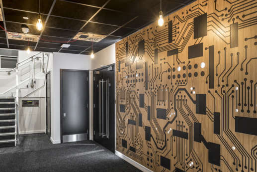Office with wooden circuit board wall panelling
