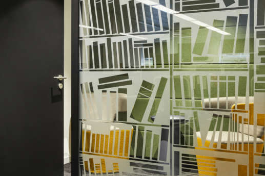 Library book decal on glass office wall