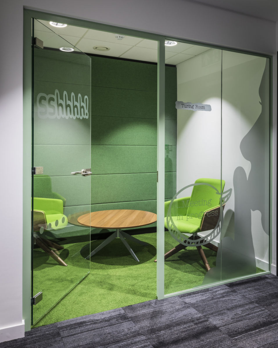 Office with green themed meeting room