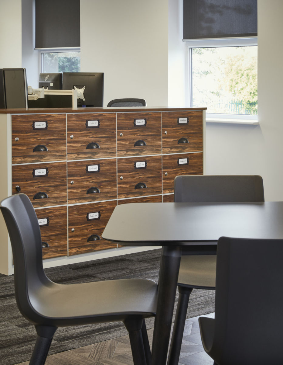 Wooden panelled storage units in chic office