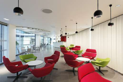 Office breakout area with colourful seating