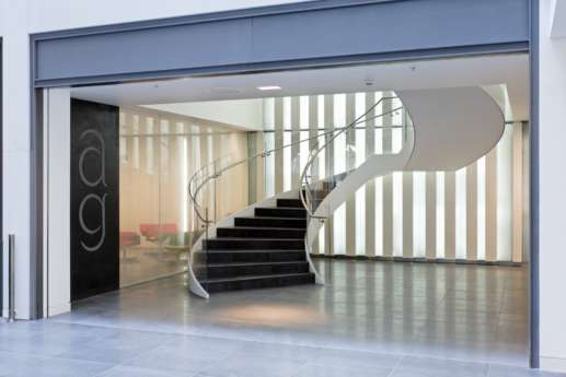Curved staircase in modern office fit out