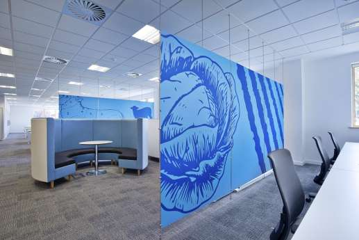 Meeting booths hidden by wall art