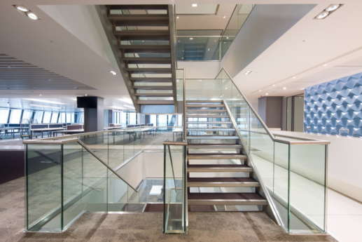 Open staircase and workstations in modern office