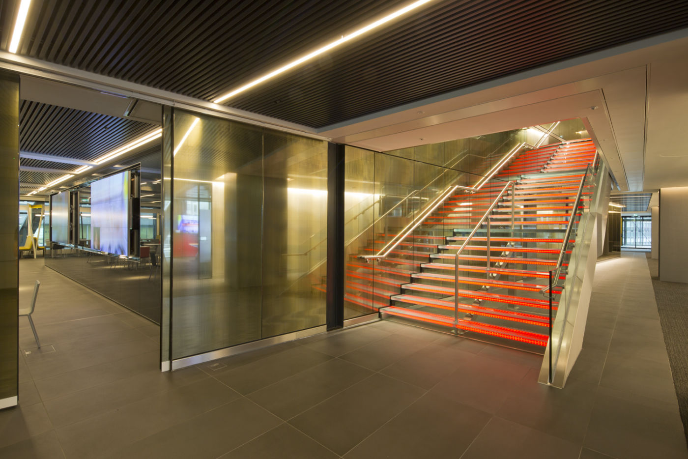 Orange stairwell in modern office fit out