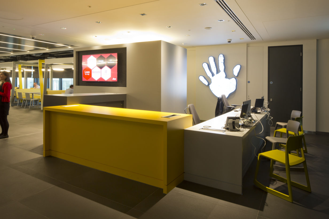 Modern office fit out with yellow and grey reception