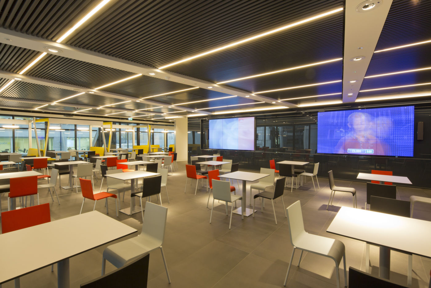 Staff breakout and cafe area with large TV screens and modern design