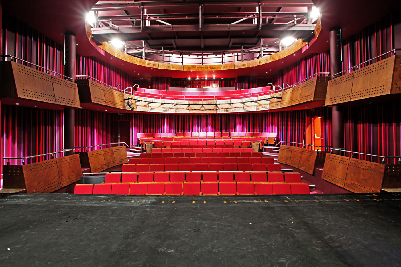 Bright red chairs in refurbished theatre
