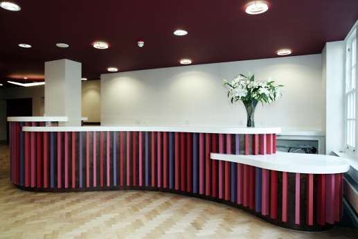 Stripey reception desk with white flowers