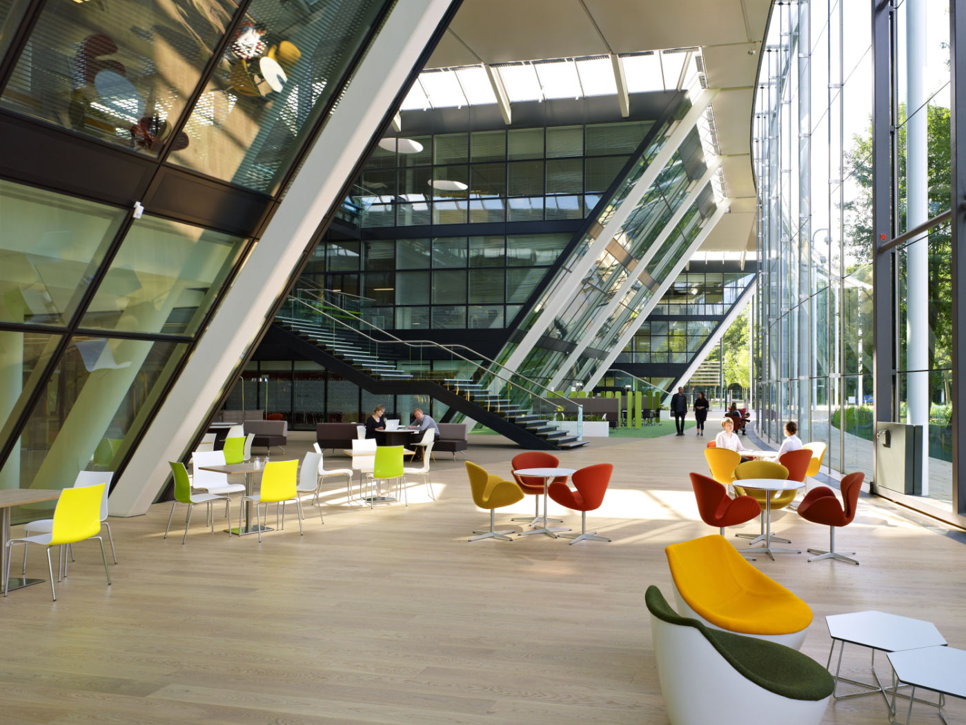 Large open plan building reception with colourful seating