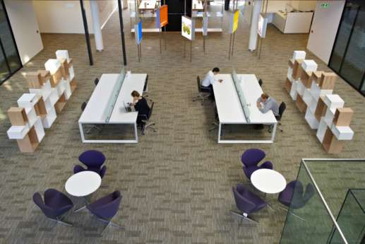 Aerial view of staff working in open plan office