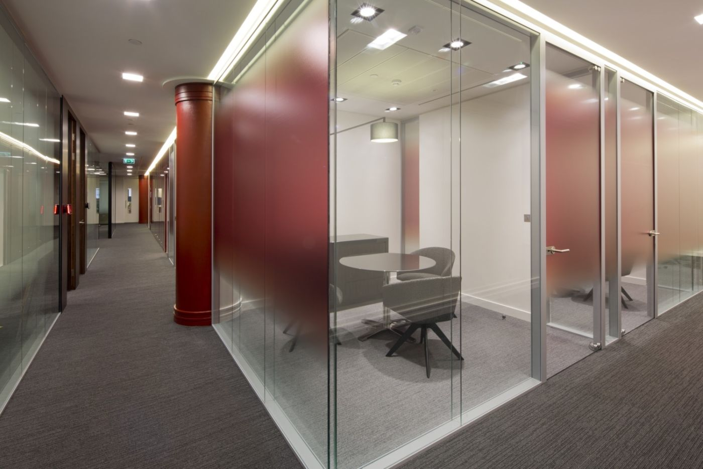 Glass meeting rooms with red highlights