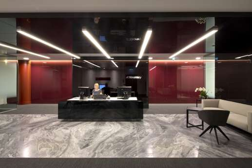 Sophisticated office reception with marble flooring