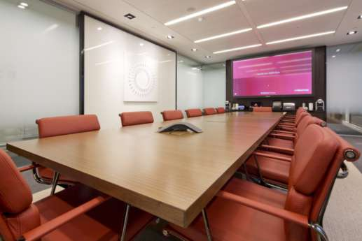 Office boardroom with red leather chairs
