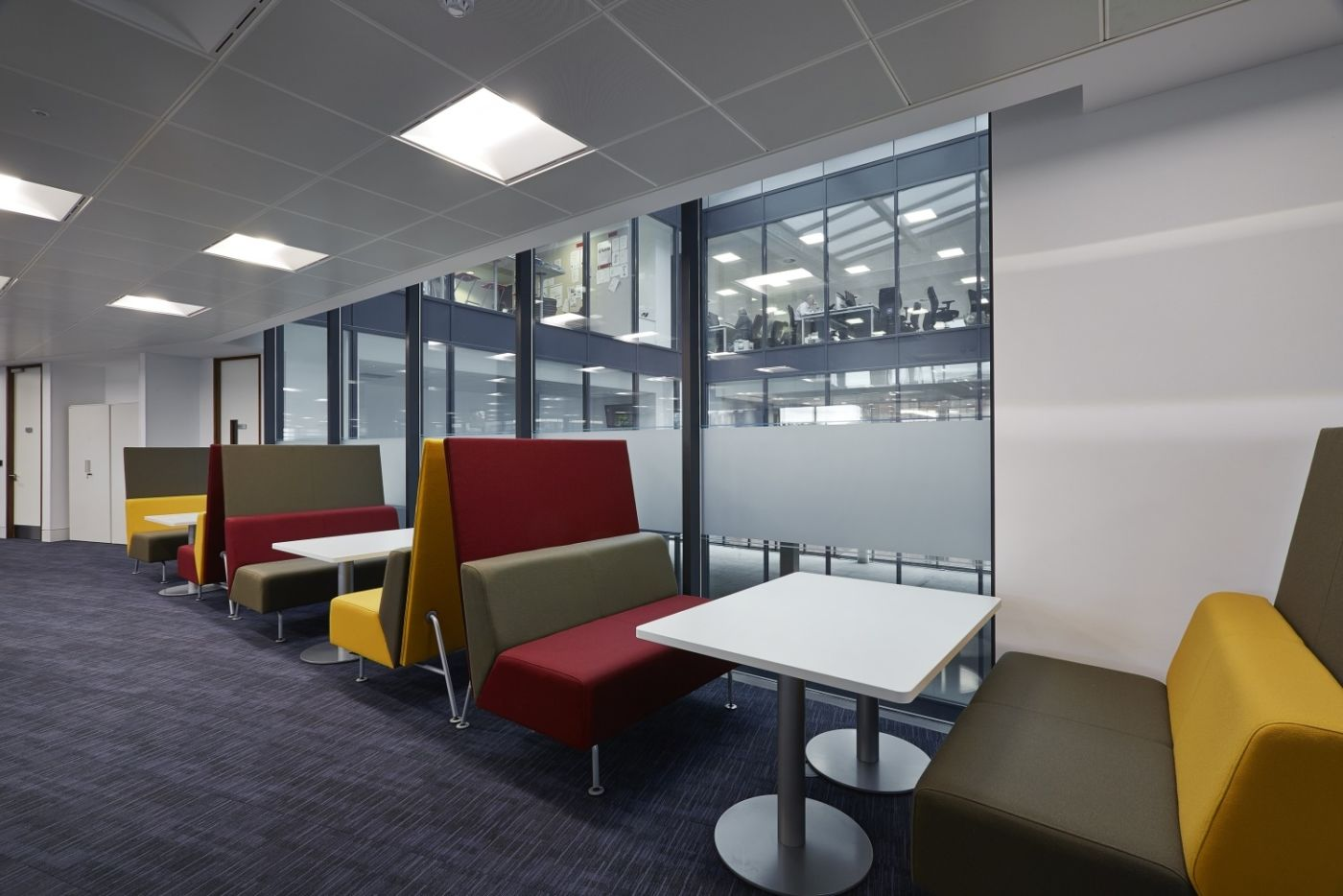Colourful booth seating in Barclay's Bristol office fit out