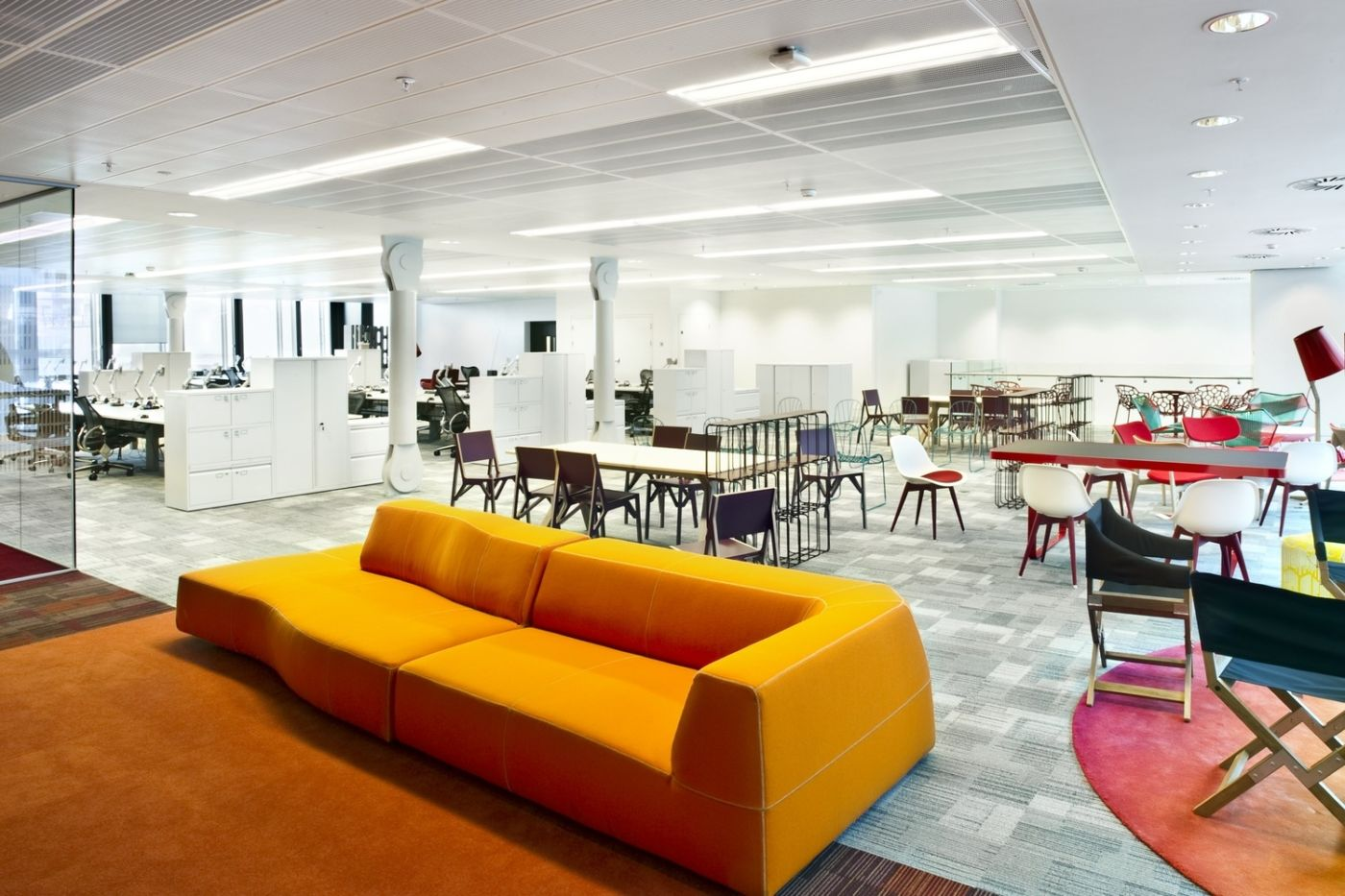 Low yellow sofa and chairs in office break out area