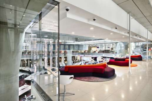 Flexible and colourful seating overlooking workstations in spacious office fit out