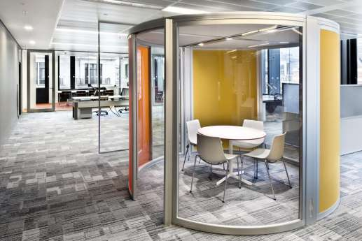 Circular meeting room in open plan office design