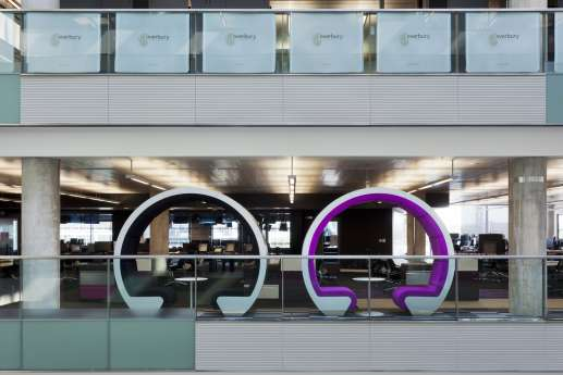 circular colourful meeting pods in open plan office