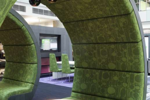 office with green private meeting pods