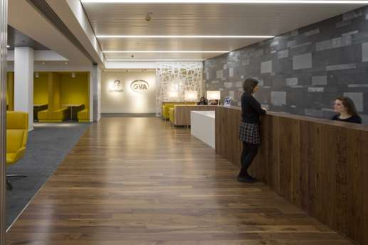 Office reception with wood paneling and flooring