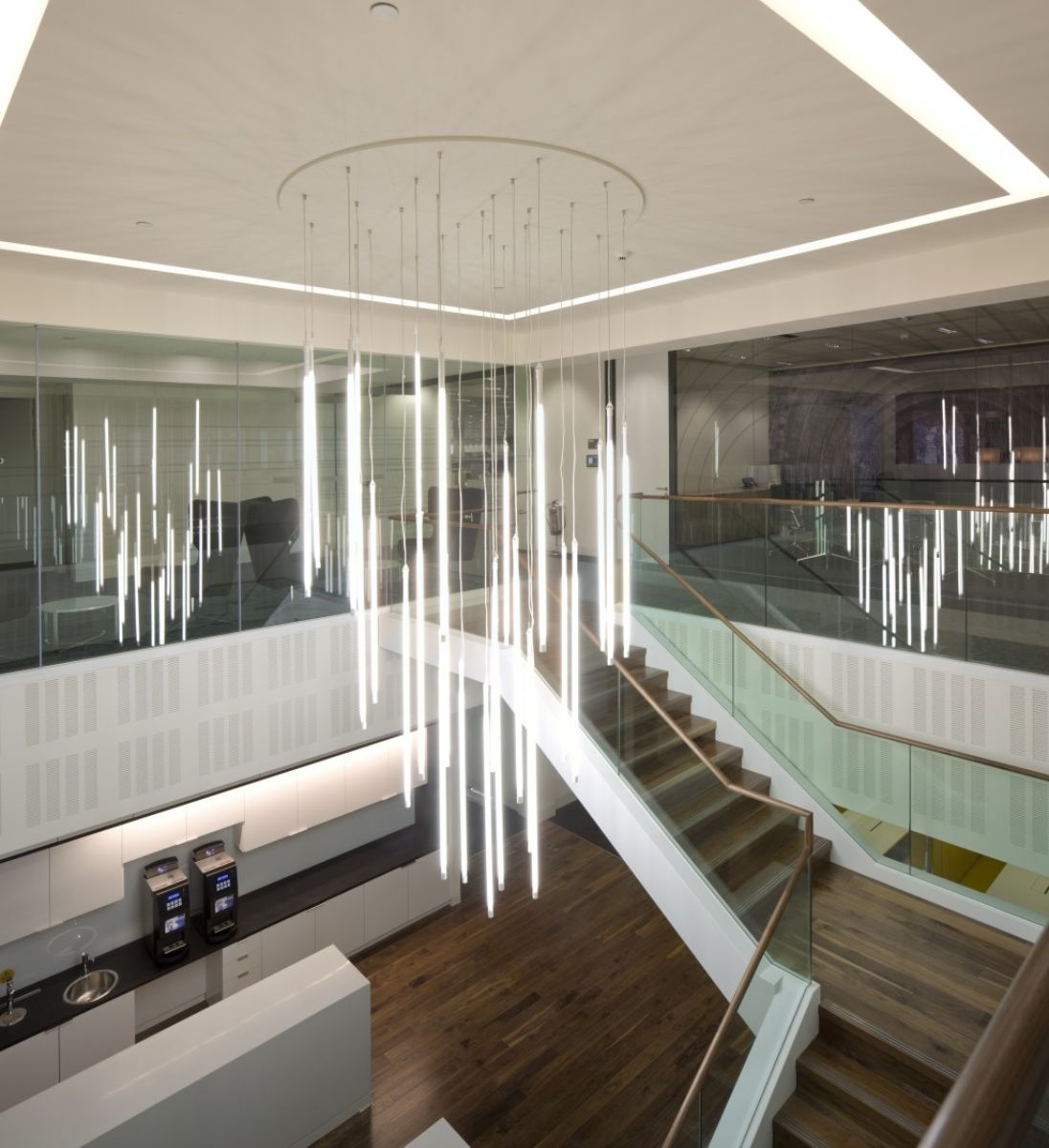 Suspended lighting above office staircase