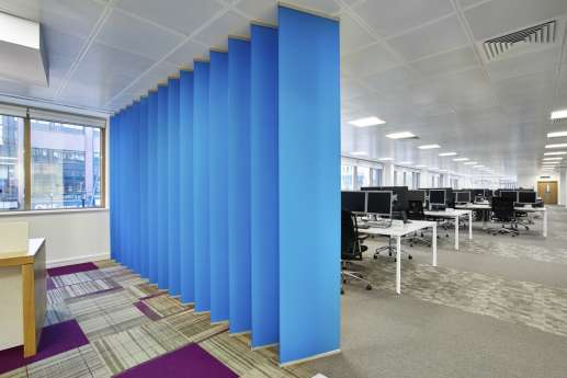 Blue slanted panels facing computer room