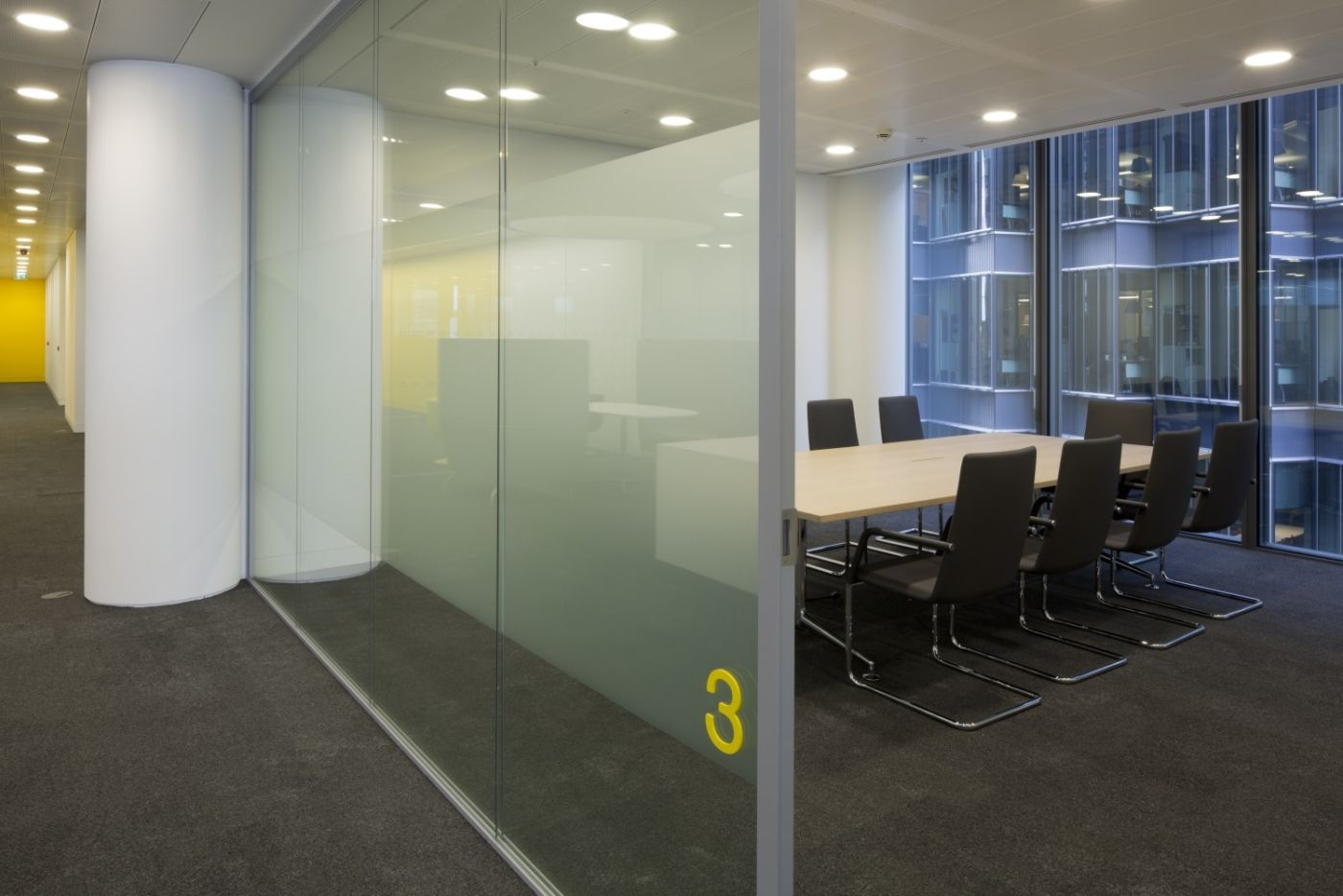smart office meeting room behind glass panel
