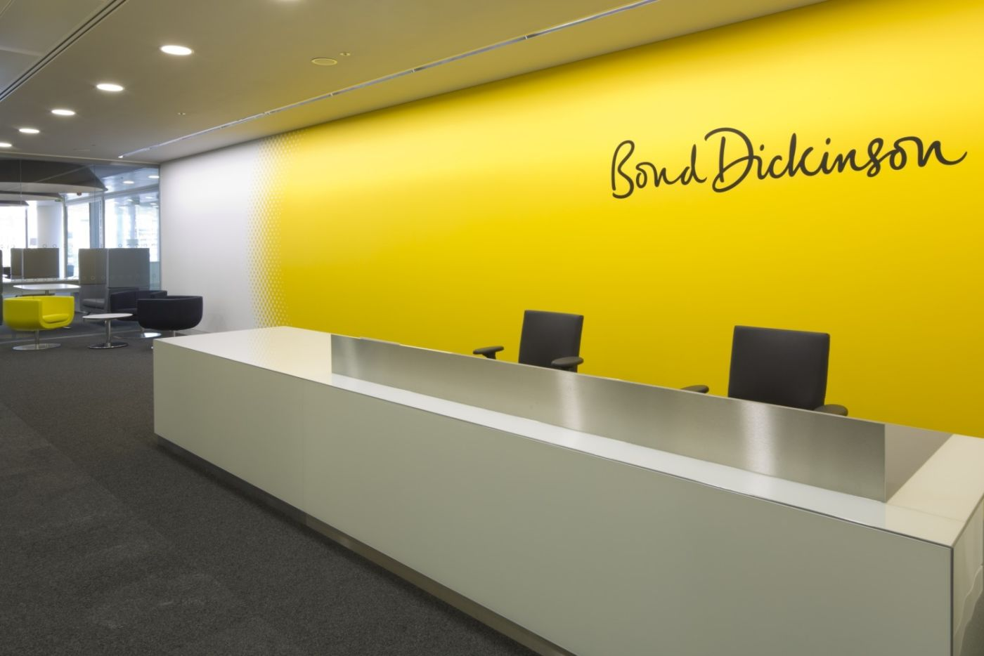Fit out of bright yellow walled reception