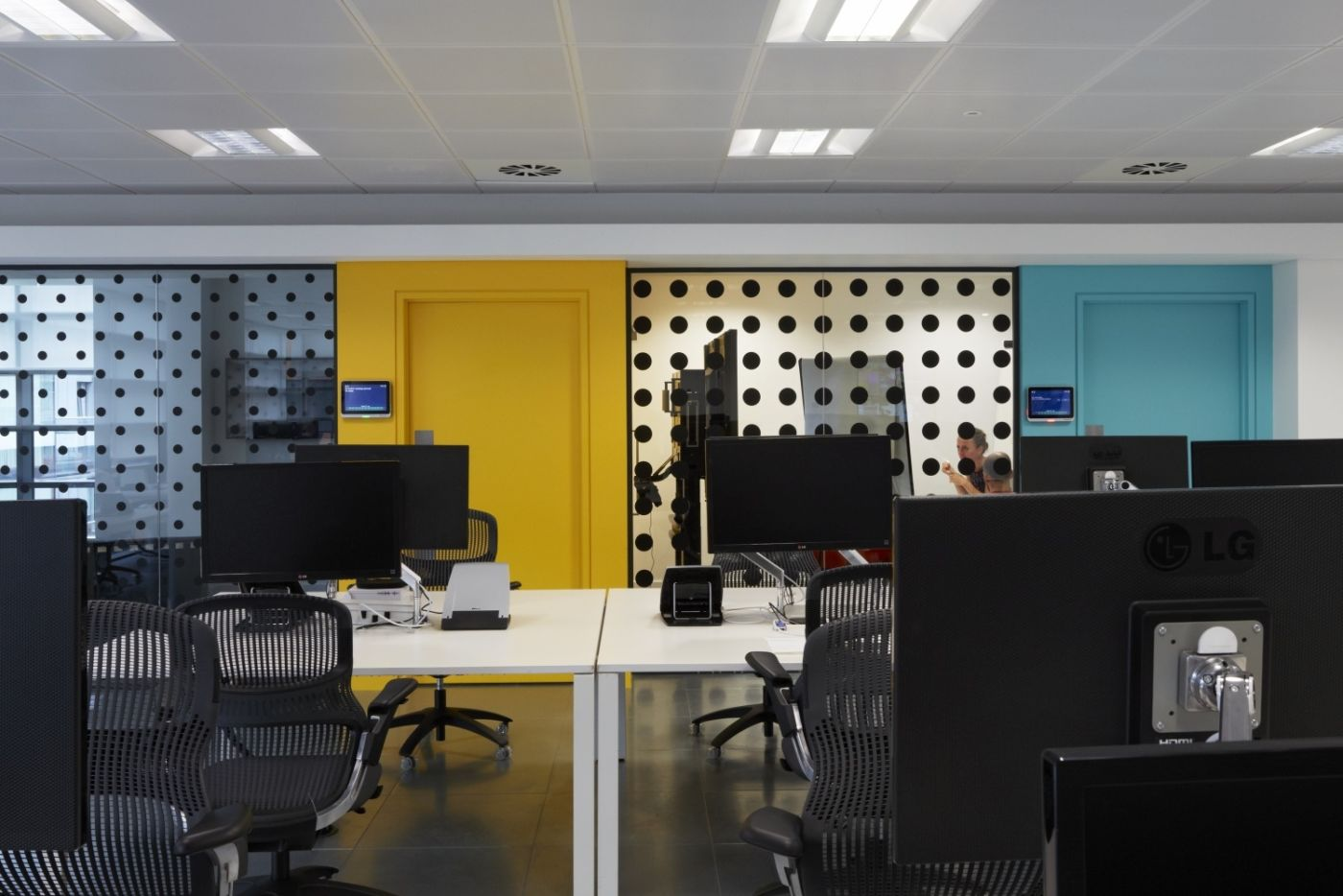 Modern workstations and yellow wall in modern office