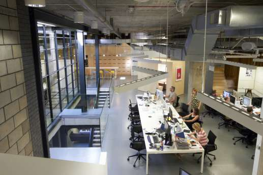 Office with high ceilings in warehouse setting