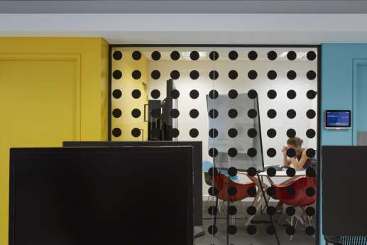 Polka dot glass-walled meeting room