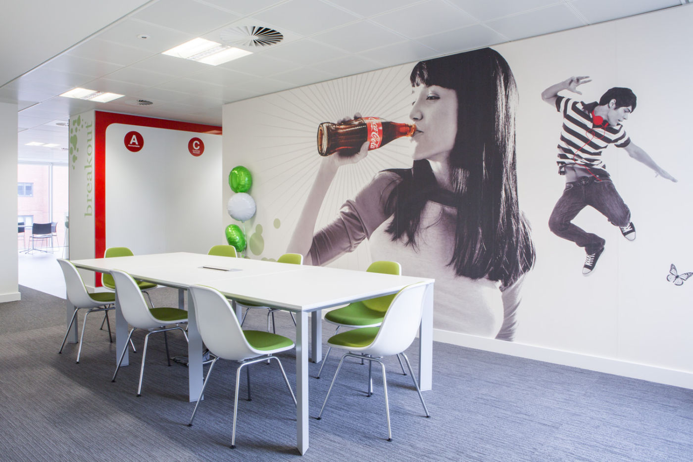 Meeting area with wallpaper of woman drinking Coca Cola