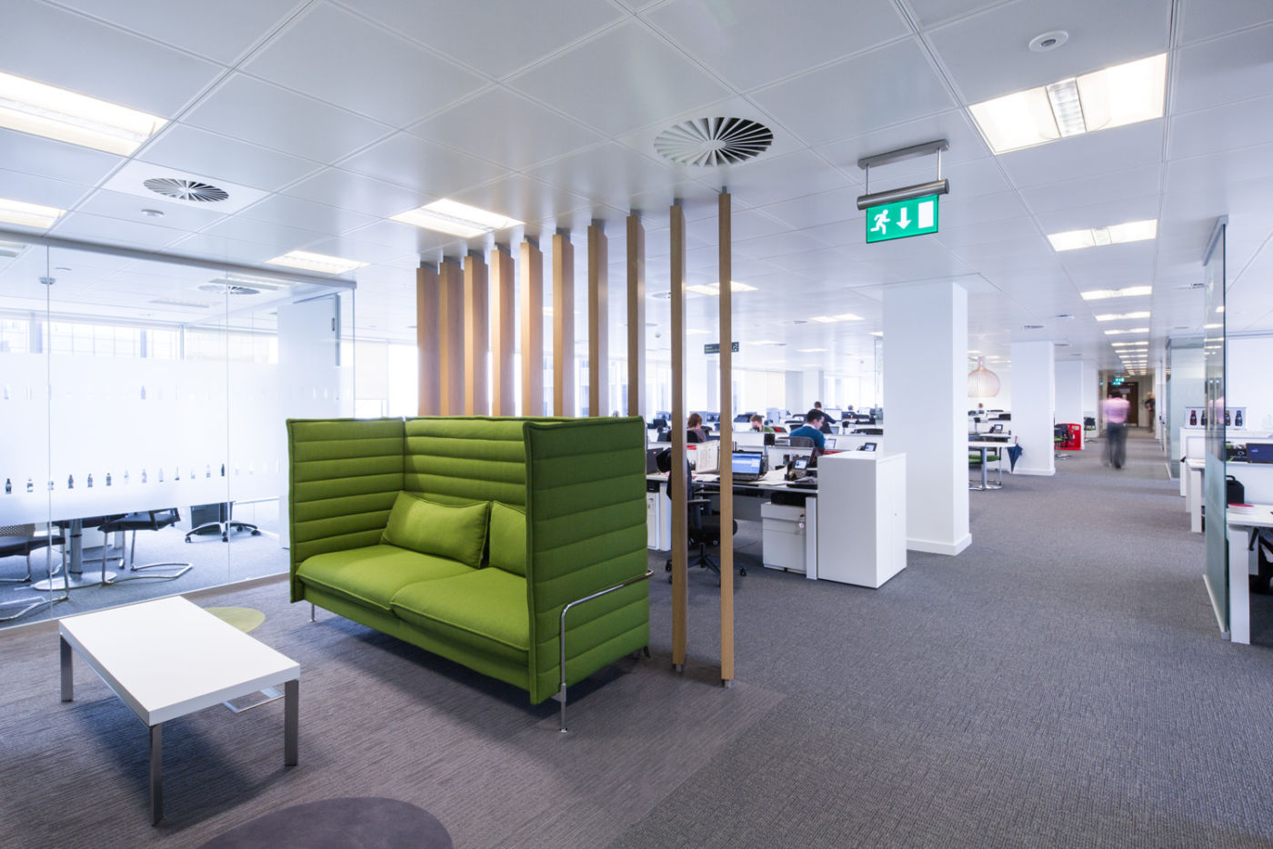 Bright green seating booth in office seating area