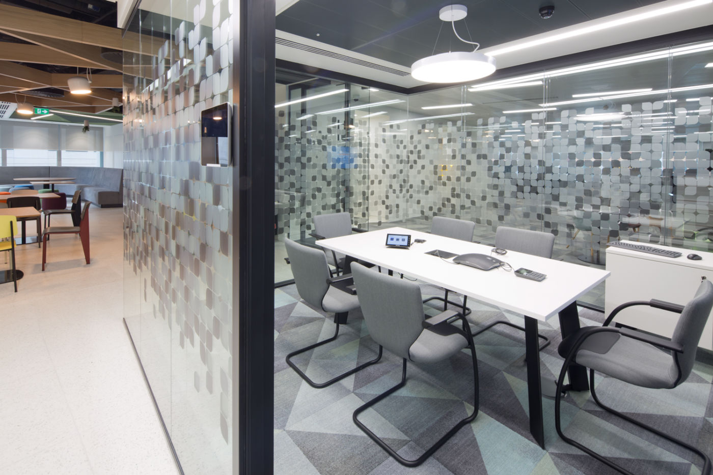 Small meeting room behind glass screen