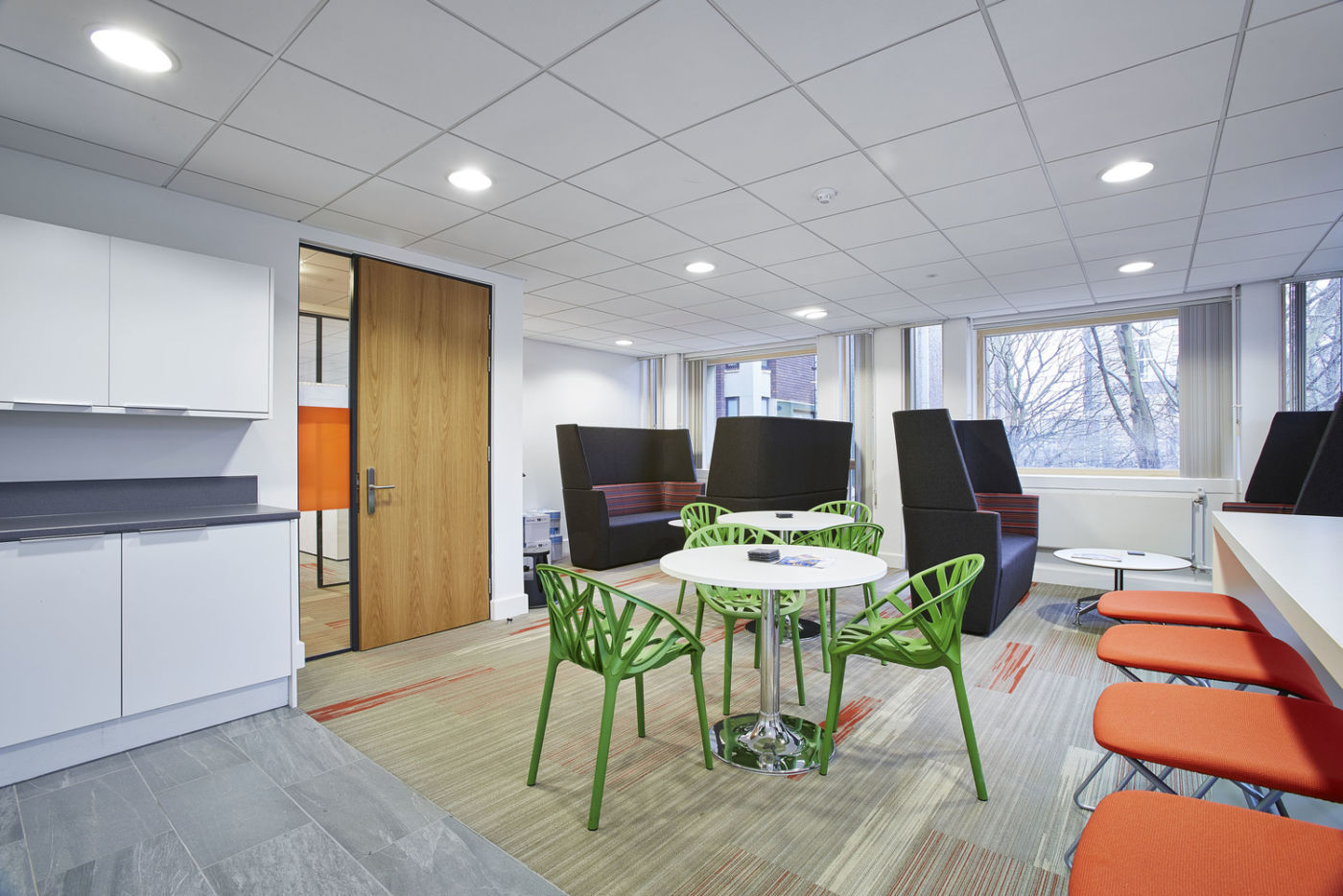 Office kitchen with bright furniture