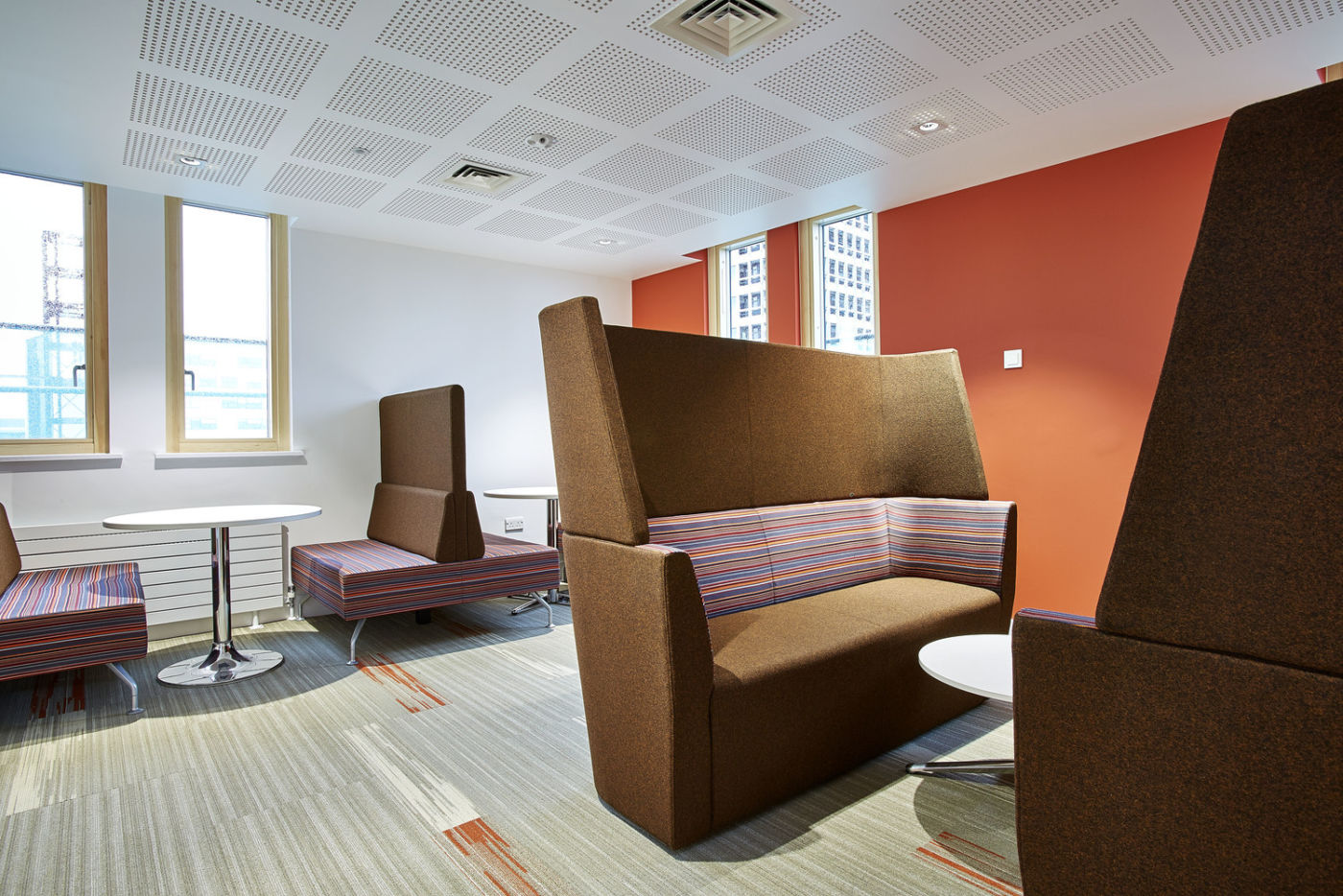 Chocolate coloured semi-private meeting pods