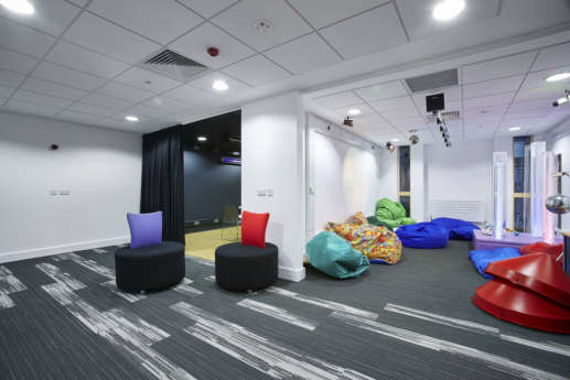 Breakout area with coloured furniture in university office