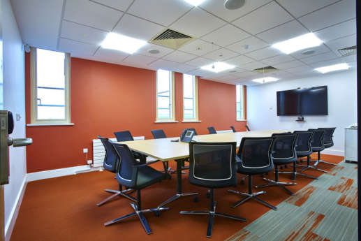 Modern office meeting room with coloured walls