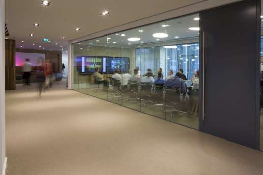 People walking in modern hallway design