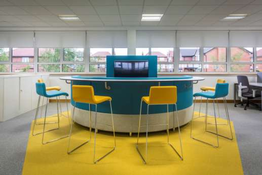 Curved booth with surrounding high chairs