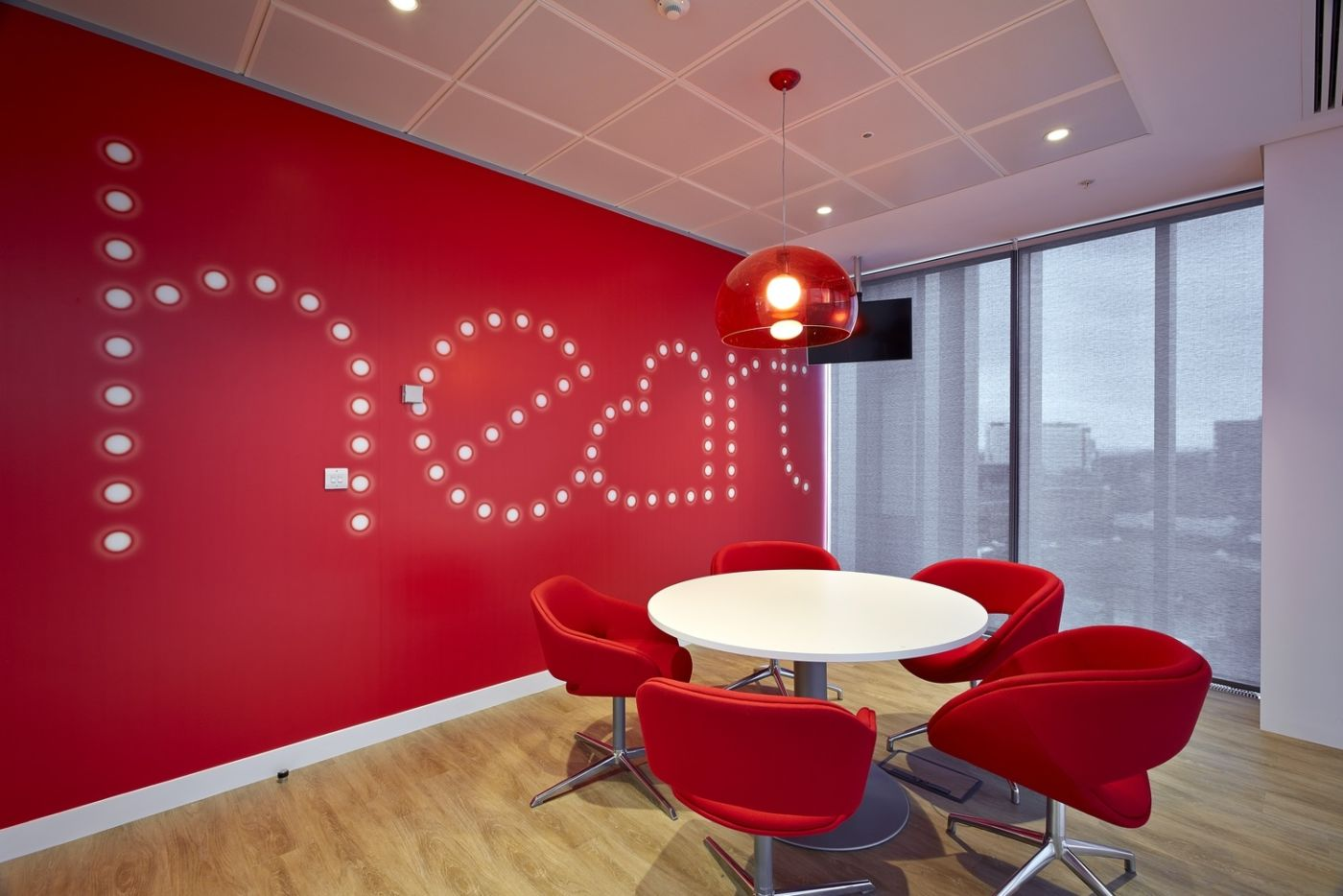 Meeting tables with bright red Heart wallpaper