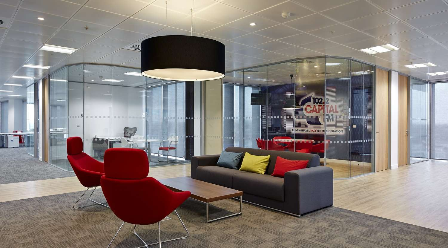 Sofa with bright cushions in casual meeting area