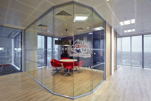 Office meeting area behind glass panels