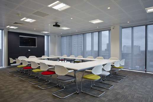 Large meeting room with floor to ceiling windows