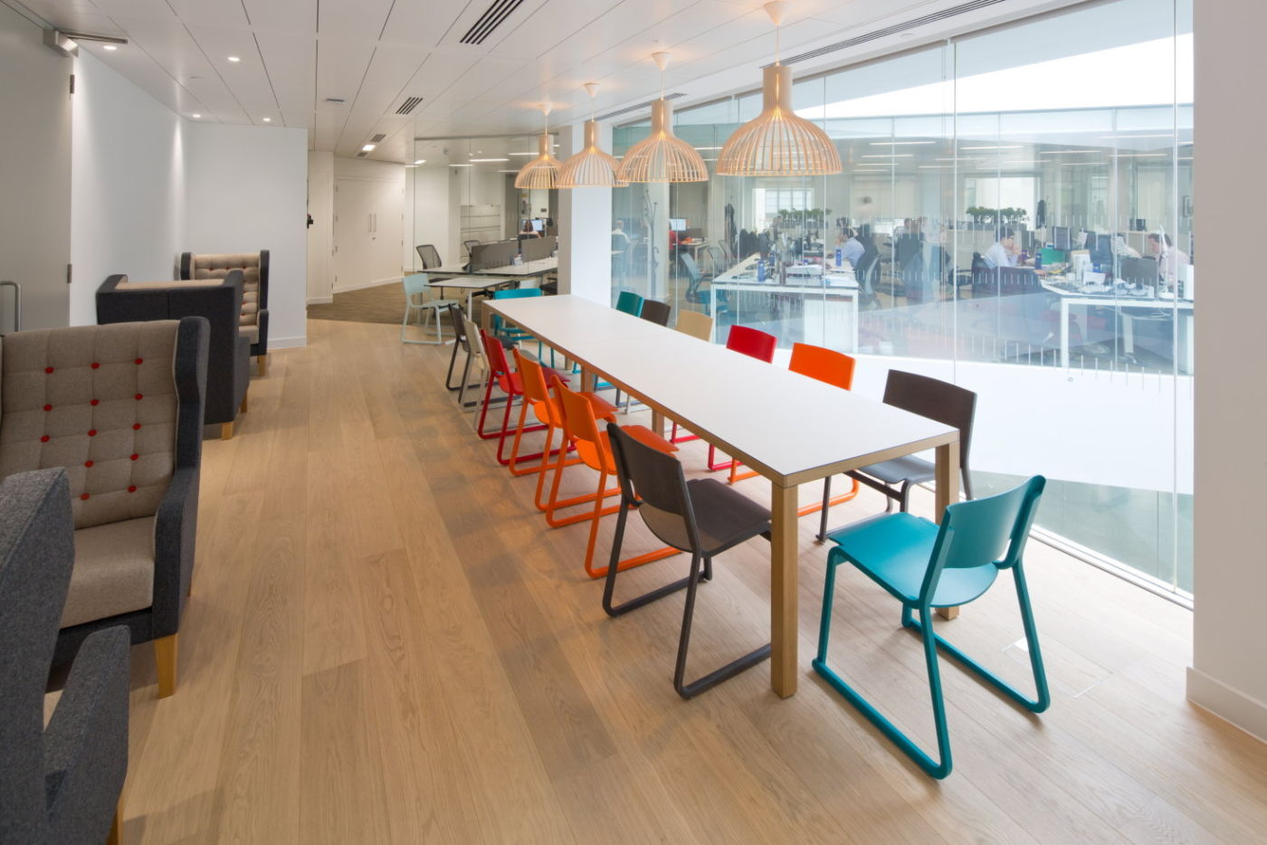 Large table with colourful chairs