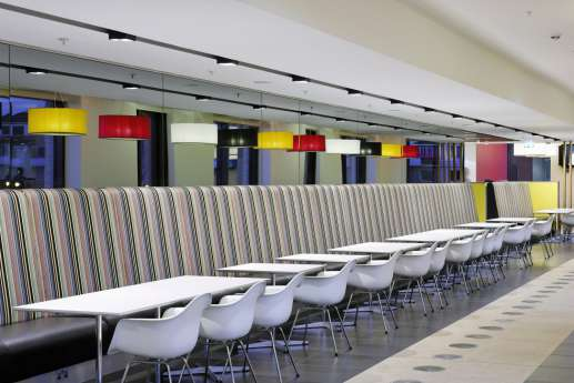 Staff cafeteria with colourful striped seating